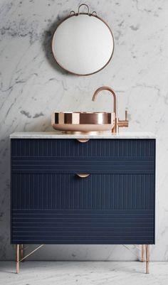 Navy bathroom vanity with brass tapware