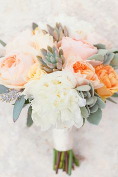 Peony + succulent bouquet, love the peach and orange / coral tones with the grey greens, less greens though and more small buds paired with the large flowers.