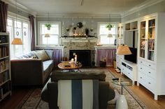 Larsson Design Ideas, Pictures, Remodel, and Decor; large scale furniture; colorful linens on windows and bookcases; clusters of ornaments over fireplace; lots of different textures