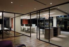 Acme 50 sliding doors and butt glazing. Inscape System & Office Specialty storage.