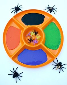 Preschool Halloween Activity-Painting with Spiders-and why haven't I thought of a veggie tray to hold paint?