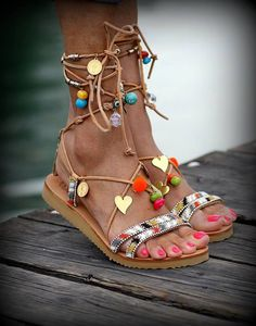 Handmade tie up gladiator sandals embellished with various semiprecious stones, pom poms in neon orange, cute shiny metal hearts and small metal