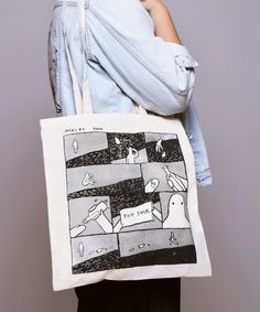 Jarjel Comics Tote Bag - AnonOffwhite with Black PrintSize: 37x41 cmArtwork by Rumi Zsofi Made by Verkstaden in Budapest, HungaryInfo for customers out of Hungary: we will charge you 1990 HUF for this product, which is approx. 6,5 €