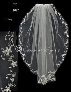 The cut edge of this embroidered bridal veil has a silver scrolling vine design adorned with pearl flowers, silver lined seed beads, glass beads and rhinestones. It is available waist length, 32 inche
