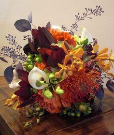 Textured Fall Bridal Bouquet    Appleton Wedding Flowers, Bridal Bouquet, hypericum berries, protea, monkey tails, calla lily, celosia, leucadendron, seeded eucalyptus, dahlias, orchids