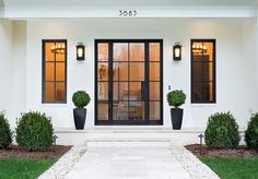 Open your entryway with these contemporary all glass front doors from Clark Hall. A bold and timeless design, these custom front doors speak for themselves. Modern Garage Doors, Modern Exterior Doors, Modern Farmhouse Exterior, Custom Front Doors, Windows And Doors, Modern Garage, Garage Door Design, Modern Exterior, Garage Door Types