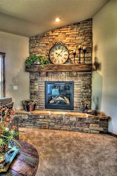 Stone and brick fireplace. This would look awesome in the corner of the living room. Wood instead of carpet flooring