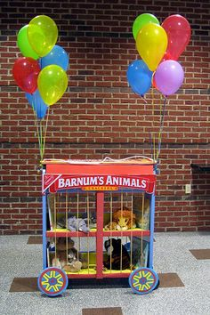 Library book cart turned into a circus cage for stuffed animals. I absolutely love this!