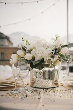 *May wedding, but white flowers are so nice 21 Winter Decor Ideas That Don't Scream Christmas A Practical Wedding: Blog Ideas for the Modern Wedding, Plus Marriage: