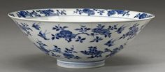 A blue and white porcelain bowl Kangxi mark and of the period Potted with a flared rim around its deep curving well and carefully painted in cobalt wash and outline with a band of prunus branches in bloom along the interior rim that also appear along with auspicious magpies in a roundel centering the floor and across its exterior walls, the six-character mark written in regular script within a double ring