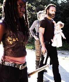 Badass Rick Grimes, you mess with the baby you get the beard! Aka the gun :) lol