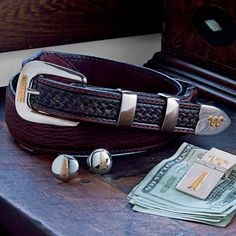 Handcrafted by Vogt Silversmith exclusively for King Ranch. The solid sterling four-piece buckle set is hand polished to a mirror finish and accented with a 14K gold-filled oil derrick and the Running W® logo. Comes with the Vogt unconditional lifetime guarantee. Imported.