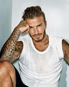 In spite of saying goodbye to his football career in David Beckham remains a style icon to millions of people across the world. Let's have a look at some of David Beckham Haircut. David Beckham Haircut, David Beckham Photos, Raining Men, People Magazine, Fine Men, Gorgeous Men, Pretty Men, He's Beautiful, Body