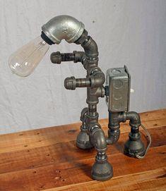 Robbie's Robot Lamp by sandhillartworx on Etsy Lampe Steampunk, Diy Lampe, Pipe Lighting, Pipe Furniture, Industrial Furniture, Iron Pipe, Pipe Lamp, Light Project, Handmade Furniture