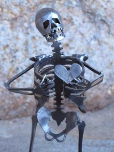 metal skeleton sculpture
