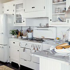 Love the stove, fridge and marble countertops. Coastal Color: White   Interesting Backdrop   CoastalLiving.com