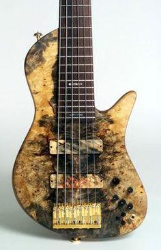 Dream bass!  A single-cut 6-string Fodera dressed in a handsome Buckeye Burl