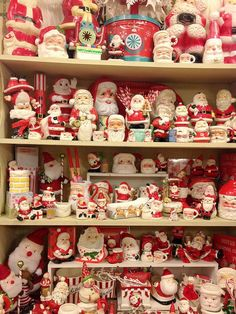 photo of a Santa collection....I'm sure there are vintage Santa's amongst all of these.: