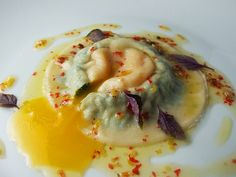 Egg yolk ravioli with crushed pink peppercorns
