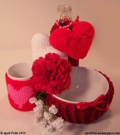 April Draven: Valentine's Day Project 2010. Free Patterns for Bowl & Bottle & Coffee Cup Cozies plus the Puffy Hearts Pattern.  Bowl Cozy can be cinched to make a little bag...very clever!