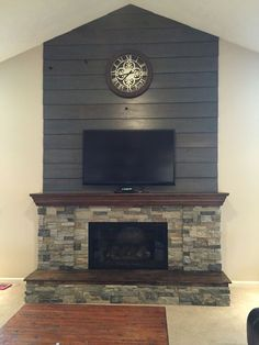 Fireplace DIY Makeover-Old barnwood shiplap cleaned up and stained gray/brown and AirStone in Spring Creek and Autumn Mountain mixed - Modern Fireplace Tv Above Fireplace, Fireplace Redo, Shiplap Fireplace, Fireplace Remodel, Fireplace Surrounds, Fireplace Ideas, Fireplace Stone, Fireplace Bookshelves, Small Fireplace