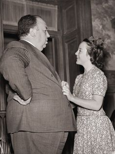 Alfred Hitchcock talks with daughter Patricia.