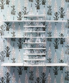 string plex - white shelves, wall panels in clear perspex, two depths – 20 cm (upper section) and 30 cm (lower section)