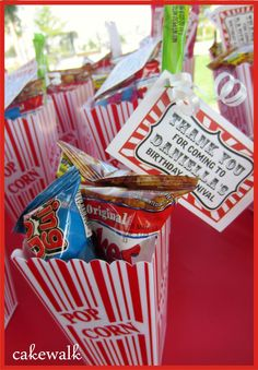 Cute party favor with the popcorn boxes and crackerjacks in side!