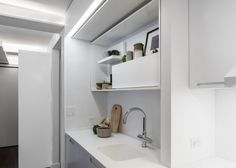 Apartment: Stunning Five to One Apartment Design and Concept in Manhattan by MKCA, Five to One Kitchen Storage Details showing Wall Cabinets and Wall Shelf for Ornaments and Decorations Display