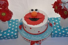 This site has some pretty awesome Elmo birthday ideas!  Elmo Birthday Cake by Cinderella Cakes Red Aqua Dessert Table Decor