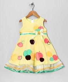 Take a look at this Pale Yellow Apple Bow Babydoll Dress - Toddler & Girls by the Silly Sissy on #zulily today!