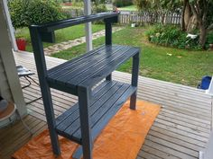 A handyBench for potplanting / seeding just made out of left over decking timber with some stain I had left over