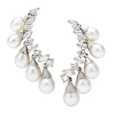 Sterle. A Pair of Diamond and Pearl Ear Clips, by Sterle, Circa 1960.  Available at FD. www.fd-inspired.com
