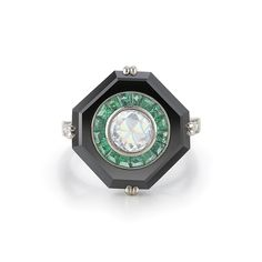 Muse emerald, onyx and diamond ring from the Kwiat Vintage Collection in 18K white gold