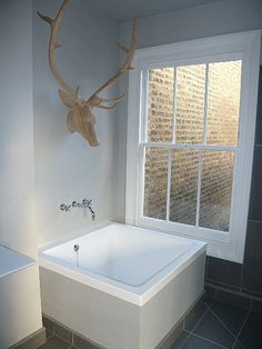 Japanese plunge bath with stags head