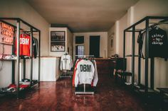 Fat Tiger is a streetwear retail destination and creative hub based in Chicago. Fat Tiger, Creative Hub, Sneaker Stores, Shop Layout, Layout Inspiration, Wardrobe Rack, Workshop, Furniture, Shopping