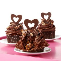 Caramel and pecan filling transforms chocolate cupcakes into a scrumptious Valentine? Topped with lovingly handmade open candy hearts using Wilton Candy Melt candy, these easy-to-make cupcakes will win hearts this February. Valentine Day Cupcakes, Valentines Day Treats, Kids Valentines, Chocolate Turtles, Chocolate Cupcakes, Chocolate Recipes, Cupcake Recipes, Cupcake Cakes, Cupcake Ideas