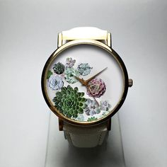 Watch. Watches for Women. Cactus. Wrist Watch. Jewelry. Succulents. Plants. Print. Leather. Gift for Her. Gardening. Indoor. Custom. Freeforme Watches 2017 I also do custom or personalized watches , please contact me and Id be glad to make something special for you and your loved ones. *Dial design and photos are owned by Freeforme Ships Worldwide Type: Quartz Wrist Size: Adjustable from 17 cm to 21 cm (6.69 inches to 8.26 inches) Display: Analog Dial Window Material: Glass Case Material…