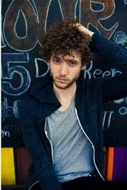 Brent Kutzle - One republic.....oh the curly hair