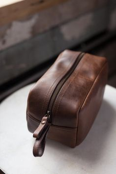 For the globetrotter on the move, our dopp kit is one that you can hold on to forever. Handmade with vegetable tanned leather in an ethical factory in León, Mexico. Leather Gifts, Leather Bags Handmade, Leather Wallet, Leather Bag Pattern, Leather Craft Tools, Dopp Kit, Toiletry Bag, Leather Accessories, Leather Working