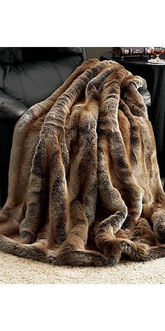 Limited Edition Coyote Faux Fur Throw - OMG these are so warm and look so real that I've gotten yelled at. :-)