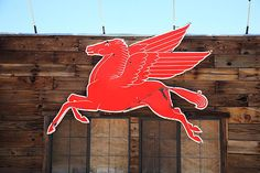 "Route 66 - The old Mobil Pegasus logo still displayed today at a remote gas station on old Rt. 66 in Arizona.  ""The Fine Art Photography of Frank Romeo."""