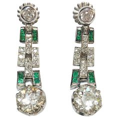 Art Deco Emerald Diamond Platinum Earrings | From a unique collection of vintage more earrings at https://www.1stdibs.com/jewelry/earrings/more-earrings/