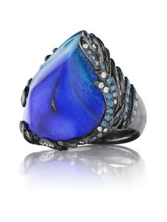 Zozo ring in 18k oxidized white gold has a 30.9 ct. Boulder opal in a wave-inspired setting with 2.35 cts. t.w. blue and white melee