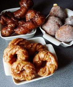 Trio Of Homemade Donuts: honey glaze French crullers, coconut custard filled yeast donuts, and honey glaze yeast donut twists. Find out more at Dessert By Candy.