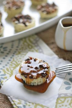Oreo Turtle Cheesecakes  12 Oreo Cookies  1-8oz. package cream cheese, at room temperature  1/4 cup sugar  1 egg  1/2 teaspoon vanilla  1/4 cup chopped pecans  1/4 cup mini chocolate chips  1/2 cup store bought caramel sauce