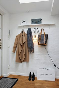 One area in the home that can be overlooked is the entryway. In some homes, it becomes a place where piles of coats, shoes and bags begin to build up. When my kids come home from school, they immediately throw their backpacks and shoes onto the floor; it becomes a construction zone within seconds! Here are a few tips to keep your entryway free from clutter.