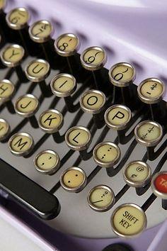 BEAUTIFUL purple typewriter from Anthro.... LOVE!