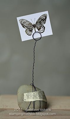 wire-wrapped rock picture holder