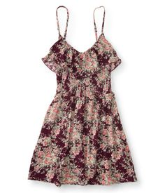"""When the sun's shining down, throw on our easy-breezy Floral Ruffle Smock Dress for stunning style in an instant. It's designed with adjustable spaghetti straps, ultra-soft fabric and a flirty ruffle, and it looks perfect by itself with just your favorite pair of sandals.<br><br>Relaxed fit. Approx. length (S): 33.5""""<br>Style: 2516. Imported.<br><br>100% rayon.<br>Machine wash/dry."""